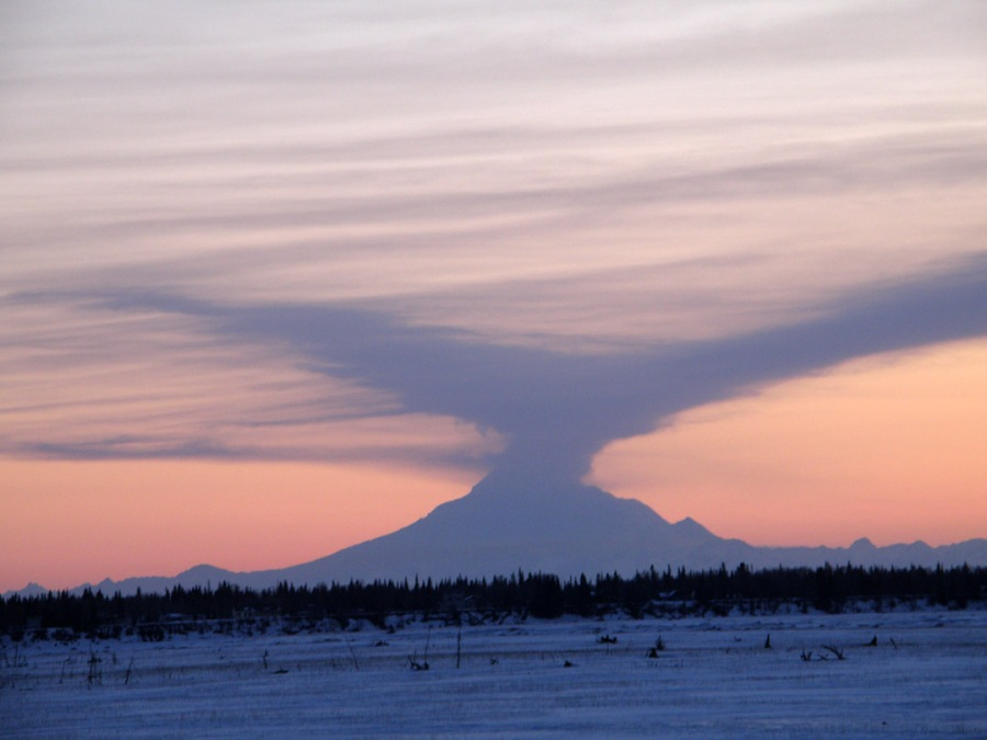 By Ralph S. Carlson, Soldotna, taken April 5, from Birdge Access Road in Kenai.  Twenty degrees. Winds.  Eyes, lenses trace ash cirrus.   Silent silhouette.