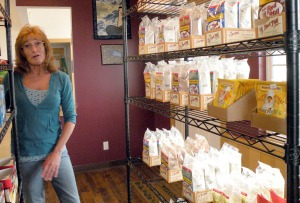Photo by Jenny Neyman, Redoubt Reporter. Loretta Paulk talks Sunday about the products she's ordered for her Gluten Free Store, for people, like Paulk, who suffer from celiac disease — an intolerance of the gluten protein in wheat.