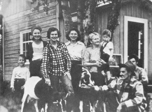 "Photo courtesy of ""Once Upon the Kenai."" Anne Lewis (in checked shirt) poses in the late 1940s at the family's home in Kasilof. In the photo, Anne is flanked by her mother, Freda Lewis, to the right, and her aunt, Florence Burton, to the left. Also pictured are other members of the Lewis and Burton families."