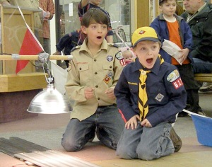 Photo by Jenny Neyman, Redoubt Reporter. Vincent Brown, left, and Jacob McConnell watch their cars hurdle down the track at the Cub Scouts Pinewood Derby races during the Scout-o-Rama on Saturday at the Peninsula Center Mall in Soldotna.
