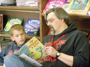 Photo courtesy of Christine Ermold, Sterling Elementary School. Roy Shapley reads to one of his students, Tyler Lingafelt, earlier this year. Shapley was a teacher at Sterling Elementary School.