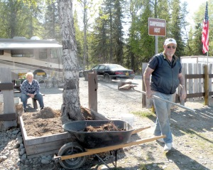 Photo by Jenny Neyman, Redoubt Reporter. William and Eunice Martens, campground hosts at Centennial Campground in Soldotna, do yard work Monday after a somewhat slower-than-normal Memorial Day.
