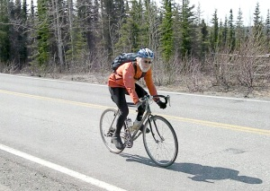 Richard Burton, of Homer, rides back toward Soldotna, and ultimately on to Kenai, from Funny River Road on Saturday.