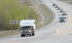 Photo by Jenny Neyman, Redoubt Reporter. An Alaska-registered motor home leads a parade of vehicles into Soldotna at the start of Memorial Day weekend Friday. Tourism businesses say bookings are down so far for the summer, but they hope to make up the loss of Lower-48 visitors with instate travelers.