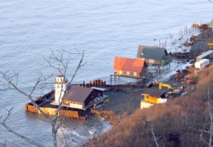 Photo courtesy of Gary Williams, borough coastal district coordinator. Seawater surrounds houses built on Hawk's Beach during a high tide in October 2007. The Hawk's Beach subdivision has suffered severe erosion since houses were built there in the mid-1990s.