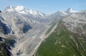 A glacier at the eastern end of Lake Clark Pass in the Chigmit Mountains is seen covered in ash last week.