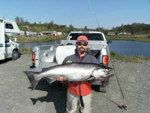 Photo courtesy of John O'Brien. John O'Brien, of Nikiski, displays the 30-pound king salmon he caught on the Ninilchik River on Sunday.
