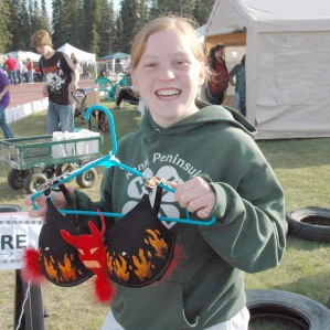 """Photo courtesy of Jacki Michels. Katie Clonan, of the Sensational Sterling Superstars Relay for Life team, displays """"The Bra From Hell"""" she made as part of the """"bras for a cause"""" fundraiser."""