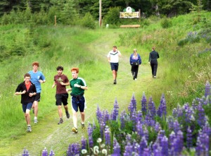 Participants in the ANR camp finish up a brief morning run on the Tsalteshi Trails at Skyview High School.