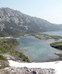 Aptly named Blue Lake is one of several snowmelt-fed lakes that dot the valley drainage along the Canadian side of the Chilkoot Trail. Designated campsites are located along the lake shores.