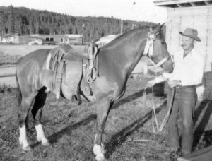 Photo courtesy of Kenai Peninsula College Anthropology Lab. Joe Faa, whose corral inspired the name of Corral Street in Soldotna, is seen here with one of his horses on his property in the 1950s.