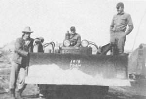 "Photo courtesy of ""Once Upon the Kenai."" Pappy Walker is seated here on his TD-6 International bulldozer. He is flanked by Floyd Head (left) and Raymond Gee."