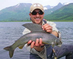 Photos courtesy of Mark Conway. Ryan Combs, of Jackson Hole, Wyo., holds a trophy-sized, 21-inch grayling. Arctic grayling in Alaska are considered of trophy size if they are 18 inches or larger.