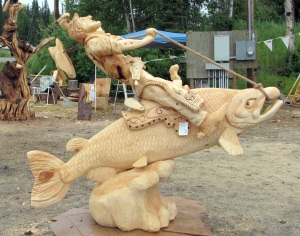 "Photos courtesy of Sandy Hanson, Town of the Living Trees. At left is ""Giddyup"" by Derek Stanton, of Nikiski. Stanton took first place and viewers' choice in the third annual Sawfest carving contest July 15 through Saturday at Town of the Living Trees in Soldotna."