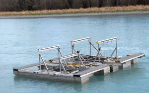 Photo courtesy of the Alaska Department of Fish and Game. Two inclined-plane traps at the Kenai Keys are used to recapture dyed sockeye smolt as part of a mark recapture project to estimate smolt abundance. Fish and Game biologists are now testing a genetic-based method of estimating smolt abundance that would eliminate the need to dye smolt captured in the Kenai River.