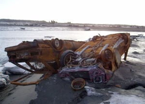 Photo courtesy of Pat Murray. Junk cars sit on the north Kasilof River bank in 2006. A rash of vehicle dumpings took place that year.
