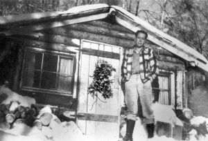 Photo courtesy of Dolly Farnsworth. Jack Farnsworth stands outside his family's first Soldotna home in the 1940s. Farnsworth was lucky to be eligible for military health care coverage when his appendix needed to be removed.