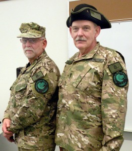 Photo by Jenny Neyman, Redoubt Reporter. Ray Southwell, left, and Norm Olson, of Nikiski, dressed in uniform for an information meeting about the formation of an Alaska Militia on Friday at the Nikiski Recreation Center.