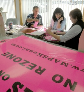 Photo by Jenny Neyman, Redoubt Reporter. From left, Richard Kelso, Colleen Ward and Pat Falkenberg address mailers encouraging a yes vote on Proposition A, which would undo a Kenai City Council zoning change in the MAPS neighborhood, at attorney Bob Molloy's office in Kenai on Saturday.