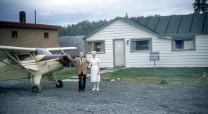 "Photo courtesy of the Isaak family. Dr. Paul Isaak and his nurse, ""Miss Meadows,"" stand by the doctor's Piper Pacer (PA20) out in front of Isaak's first clinic in Soldotna in 1960 or '61. This clinic stood about where Soldotna's current fire station stands."