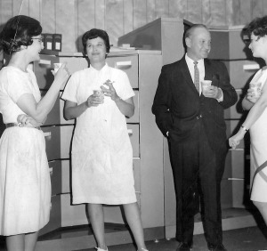 Photo courtesy of Gloria Wisecarver. Dr. Struthers' nurse, Gloria Crandall (center), chats during a social function in Kenai in the mid-1960s.