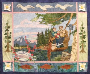 This quilt block, part of the Alaska statehood anniversary quilt project, shows how early Funny River homesteaders used a homemade cable car to cross the Kenai River.