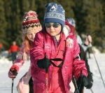 Bundled in pink, Sarah Mickelson focuses on staying upright as she cruises the groomed trail along the lake.
