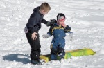 Parker Lockwood, 7, helps Cayden Huff get back on his feet and ready for another ride.