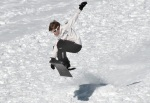 Photos by Jenny Neyman, Redoubt Reporter. Luke Beiser catches some air off a jump on a sledding hill behind Skyview High School on Monday. Sunny, warm weather had sledders out in force on the first day of spring break.