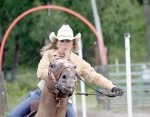 Photos by Clark Fair, Redoubt Reporter. Beth Fowler guides her horse around the next pole in the pole-bending competition.
