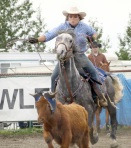 Becky Dragseth and her horse, Diesel, pursue their bovine prey in the Breakaway Roping event.