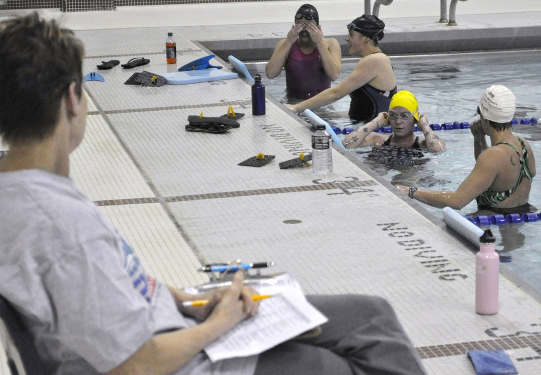 Like a personal trainer in a gym, Wainwright helps swimmers by offering ...