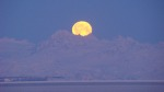 """Spring Moon."" The moon sets over Mount Redoubt at the end of a long winter, taken in March by Cynthia Colton, of Kasilof."