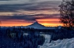 "Honorable Mention: ""Spring Sunset Over Mount Redoubt,"" by Nancy Dean. ""With the coming of spring comes the beautiful sunset again, such as this shot taken at the top of the hill on Moose Range Drive on March 17."""
