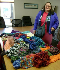 Photo courtesy of Kenai Peninsula Food Bank. Janet Ollivier, of Kenai, donated 21 hats and 28 scarves to the Kenai Peninsula Food Bank on Nov. 20. Even though her own health makes her unable to work, she still finds a way to contribute to her community.