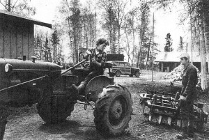 Photo from a Better Homes & Garden article about the Lancashires, published in February 1955. Rusty Lancashire maneuvers a tractor so husband, Larry, can hitch up farming equipment at the couple's homestead in Ridgeway.