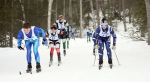 Figure 10: Tucked low out in front of this group of skiers are, left to right, Sergei Wegner, of Valdez, Nate Mole, of Kenai Central, and Cole Covey, of SoHi, at the 2011-12 Region III meet at Tsalteshi.