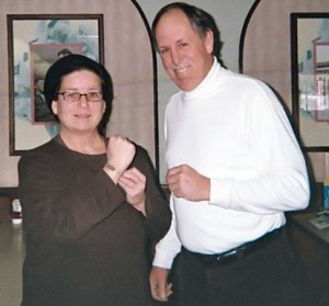 Margaret Ball, Arlon Ball's daughter, poses with a bracelet of her father's, with Jim Littlefield, who led an archaeological dig in Niantic, Conn., in which the bracelet and other items belonging to Ball were found.