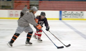 Photos by Jenny Neyman, Redoubt Reporter. Alaska Ambush coaches Shannon Murray, right, and Heidi Hanson jostle for the puck during a practice scrimmage last year.
