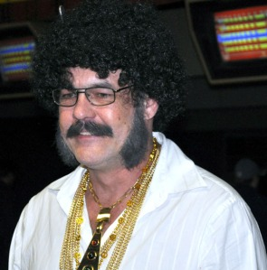 Jamie Emery, bowling on the Udelhoven team during Saturday's event, didn't seem distracted by his huge Afro or numerous gold chains. He was one of many bowlers who embraced the '70s theme.