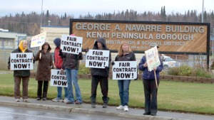 Photos by Jenny Neyman, Redoubt Reporter. Kenai Peninsula Borough School District teachers and support staff hold signs rallying for the settlement of ongoing contract negotiations Oct. 15 outside the George A. Navarre Borough Building.