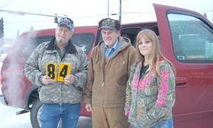 Keith Phillips and Tom Netschert, with the Kenai Peninsula Chapter of Safari Club International, and Laurie Speakman, with the Alaska Moose Federation, get ready to go update moose warning signs on the central peninsula area Saturday.