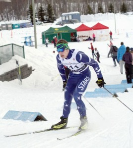 Luke Michael, of Soldotna High School, leans forward to gain speed up an incline at the state cross-country skiing championship in Anchorage last year.