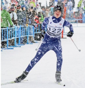 Tanner Best, of Soldotna High School, kicks off his right foot onto his left, gliding foot  at the state cross-country skiing championship in Anchorage last year.