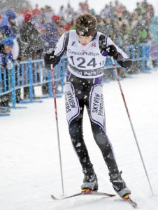 Sky Schlung, of Skyview, plants his poles with his arms at a 60-degree angle in the state cross-country skiing championship in Anchorage last year.