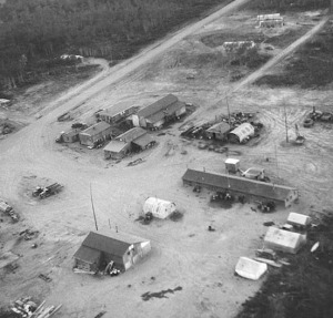 Photo by Al Hershberger. This aerial photograph shows the Alaska Road Commission headquarters on July 4, 1949, about two miles east of the village of Kenai. This is the current location of Wal-Mart.