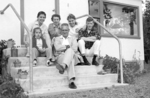 Photo courtesy of Hardscratch Press. During the summer of 1959 at their Division of Highways home near Soldotna Creek, the Soberg family posed for this portrait. Ralph and Ruth Soberg occupy the center. They are flanked on the left by daughter Jackie and Ruth's niece, Susan Rorrison, and on the right by daughter Jerry and her husband-to-be, Ronald Fallon.