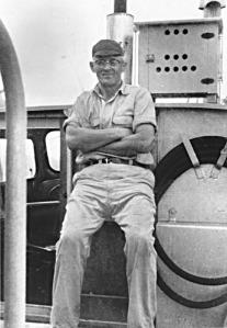Photo courtesy of Hardscratch Press. In 1964, two years after his first retirement, Ralph Soberg posed for this photo on his gillnetter.