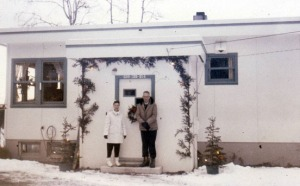 The Sobergs stand outside their ARC home at Soldotna Creek, likely in the 1950s. This building, now refurbished, is the new home of the Kenai Watershed Forum.