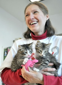 Photo by Joseph Robertia, Redoubt Reporter. Judy Fandrei plays with two kittens at the Kenai Animal Shelter last spring. Her time spent at the shelter drove Fandrei to start the Peninsula Spay and Neuter Fund, which helps educate people to the pros of spaying and neutering pets, and can help offset the cost of surgeries for those in need of financial assistance.